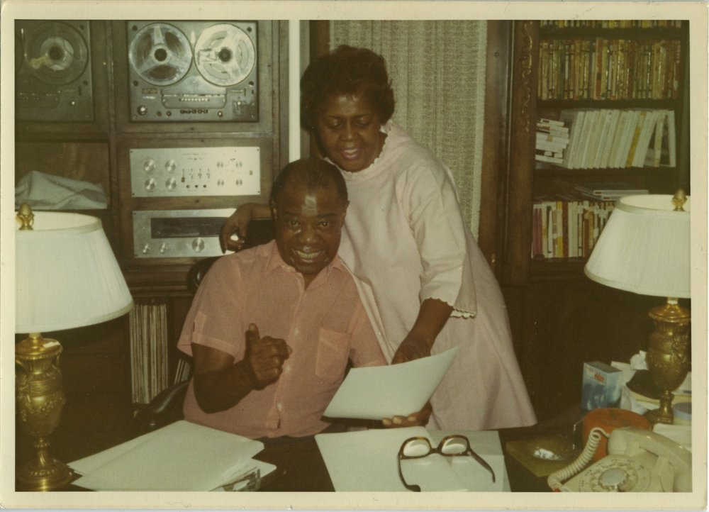 Louis Armstrong and his wife Lucille in the den of their Corona, Queens, New York home; the jazz legend's archives are now available online.  PHOTO courtesy of Louis Armstrong Archive.