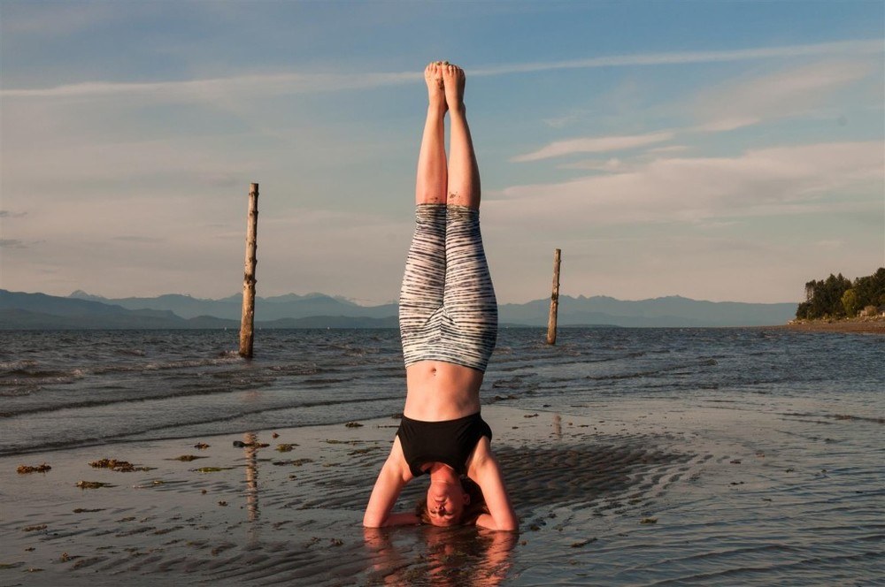 beach head stand yoga