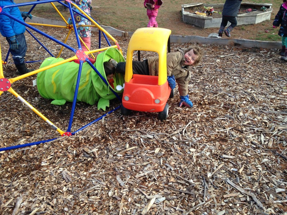 Success in the play yard!   Hard work to link together tunnel plus car, then climb all the way through!