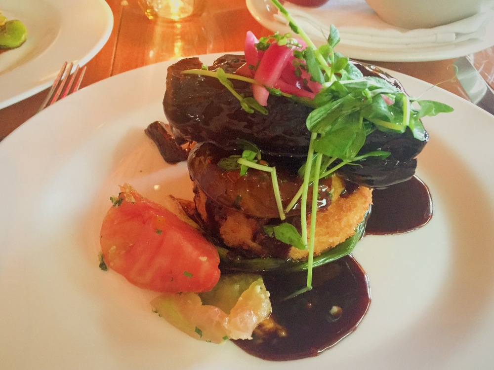 Creekstone Farms Beef Short Rib:  smoked mozzarella risotto cake, heirloom tomato, pickled red onion, merlot reduction