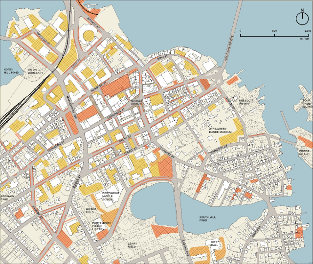 Downtown parking lots: orange are public and yellow are private. Image by Manypenny Murphy Architecture.
