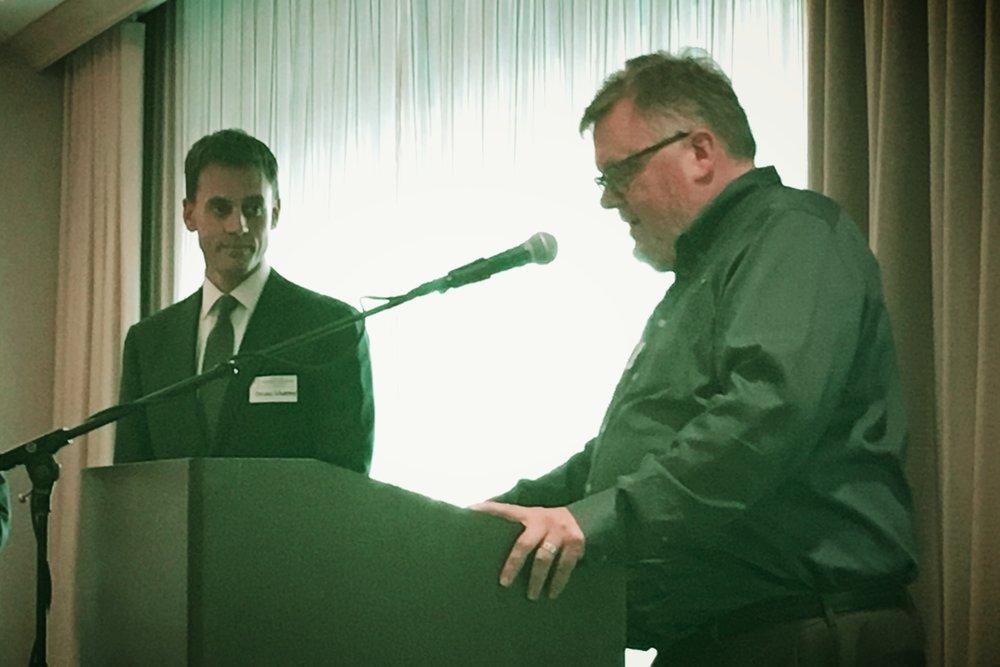 Workforce Housing Coalition Board Chair Kim Rogers presents the award