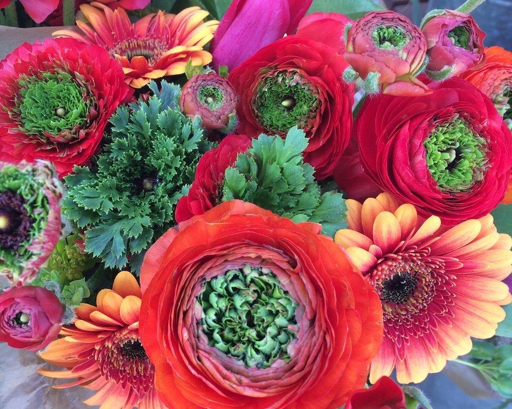 *ranunculus, gerbera daisies, tulips