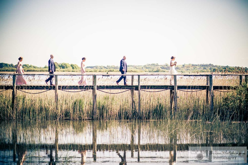 Glasson House Hotel- Bride Groom and Bridal Party walking on jetty