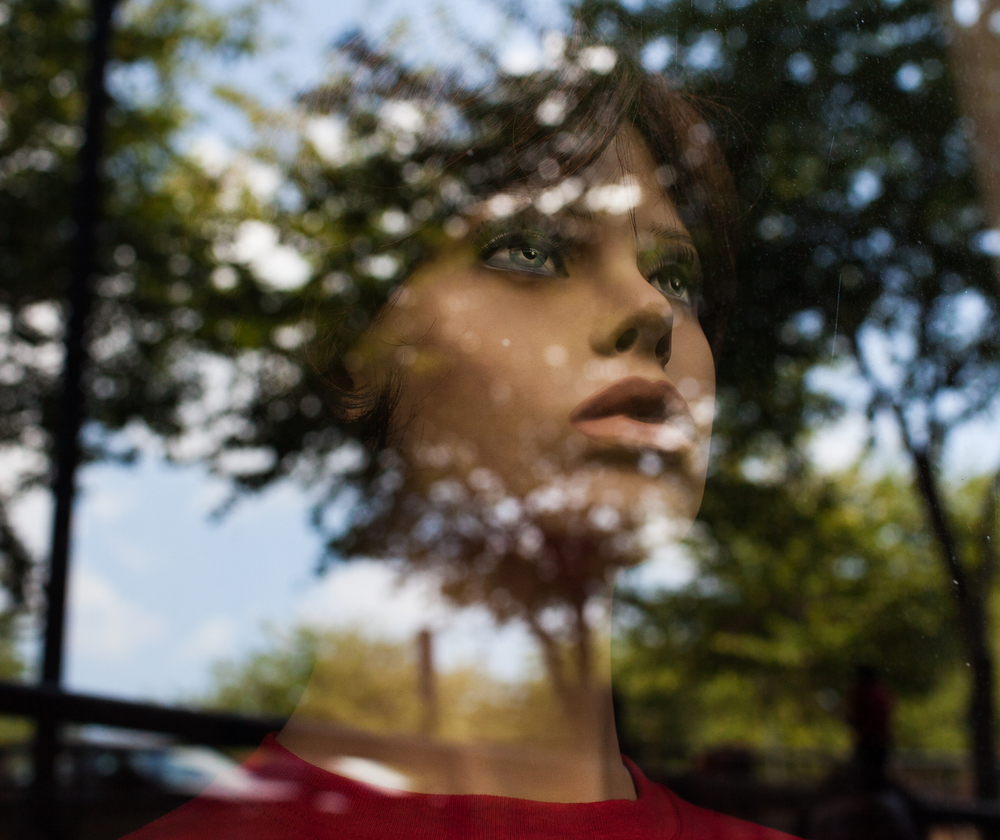 A mannequin sits on the window seal in the Academic Complex, at Western Kentucky University.