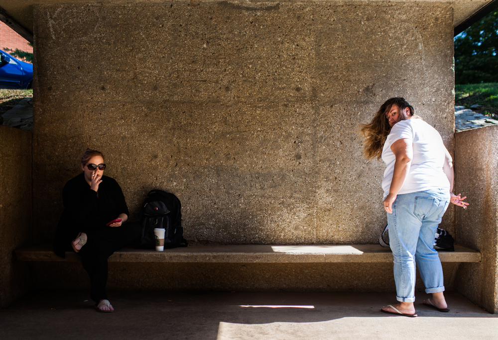 Kristina Thames, left, and Jamie Davis, right, take a smoke break from attending class at WKU. The Academic Complex's underpasses on WKU's campus is a well-known oasis for many of the students, especially on hot September day.