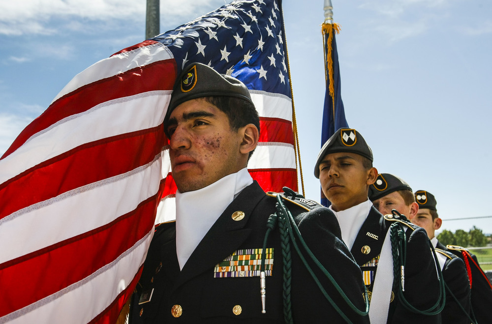 Angel Ruiz, a junior at Taylorsville High School and part of the ROTC, prepares to walk on the field during opening ceremonies at the 4A and 5A softball championship games in Taylorsville, Utah, on Thursday, May 26, 2016. The Spanish Forks beat Maple Mountain 5-2.