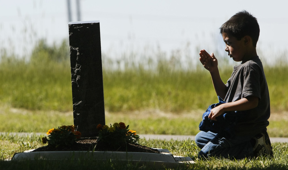 Son of a Marine Corps League member, Xavier Deihl, 5, salutes a grave in honor for those who have served in the military at Mt Olivet Cemetery in Salt Lake City on  Saturday, May 28, 2016.