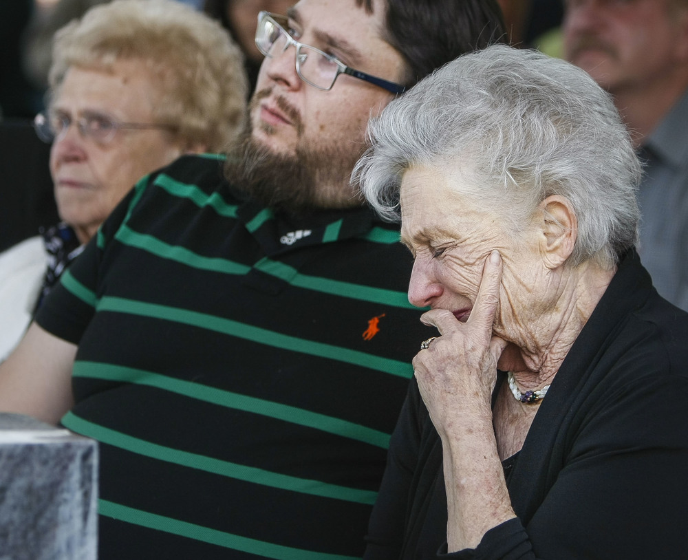 Patrica Laissez, right, gets emotional during a memorial service in Salt Lake City on Friday, May 27, 2016, for those who donated their bodies to the University of Utah School of Medicine. After the bodies are studied or used in research, they are cremated and the remains are then given to the family or buried in the Salt Lake City Cemetery.