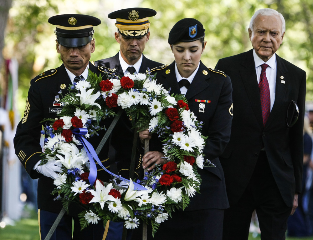Members of the military carried the memorial day wreath to the entrance of the cemetery at the Memorial Day March and Ceremony that was held at Fort Douglas Cemetery in Salt Lake City, Utah, on Monday, May 30, 2016.