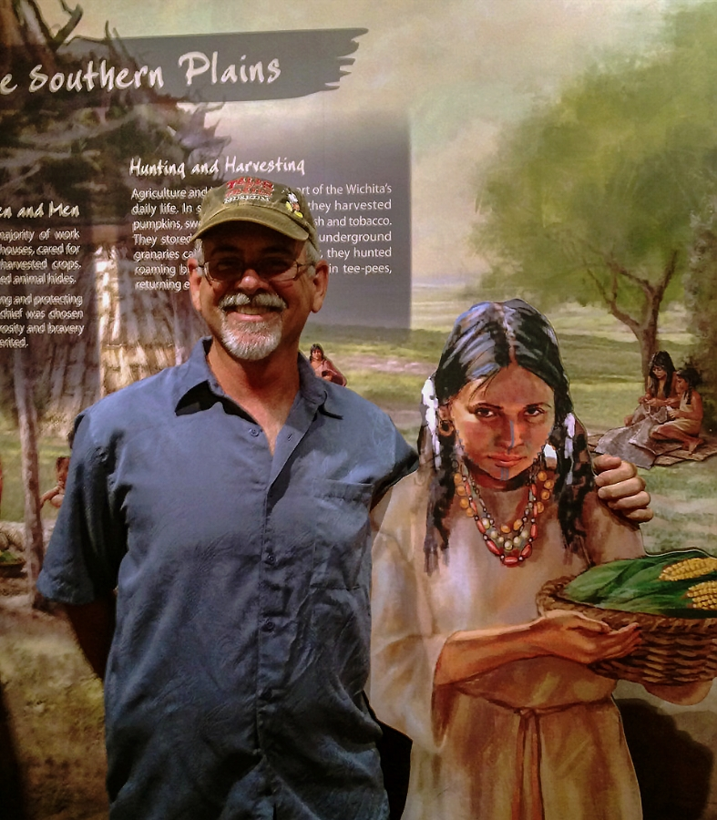 """""""Native girl""""- Stand off • This visitor shares a smile with the Witchita Life mural stand-off • Tales N' Trails Museum, Nocona, TX. © KT"""