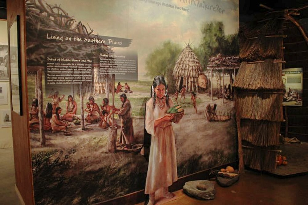 """Wichita Life Mural"" – Native girl (life size) stand off • Rendered digitally in Photoshop, scene depicts the habitat and the lifestyle of a Wichita tribe. • Tales N' Trails Museum, Nocona, TX.  © KT"