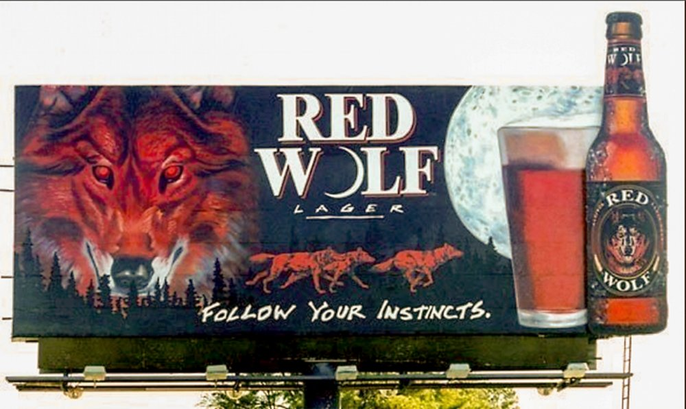 "Outdoor Advertising- ""Follow Your Instincts"" • Red Wolf Lager. 14' by 48' billboard, hand painted in bulletin enamel.. © KT"