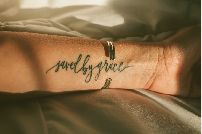 Saved by Grace Custom Calligraphy Tattoo Design - Arm