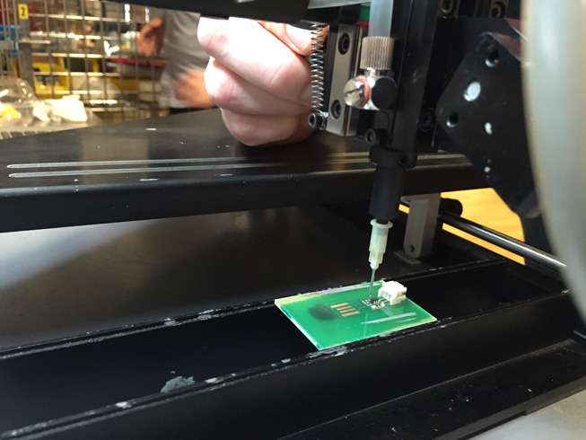 placing components using the pick-n-place machine.