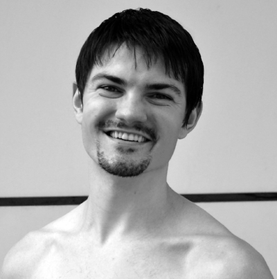 riginally from Maine (USA), Russell Hewey trained under Lynne Penn-Davison and Cosmin Marculescu while performing with Portland Ballet, Ballet New England, Konservatoriet Dance Ensemble, Ajkun Ballet Theatre, and José Mateo Ballet Theatre.   In 2010 Mr. Hewey joined Teatrul de Balet Sibiu (TBS), in Romania, where he has had the fortunate opportunity to work with Ballet Masters Florin Brindusa, Pavel Rotaru, Mihai Babuska, Dorin Ioan Coseriu, Tatiana Panaiotidi, and Alex Fotescu.   Within TBS, He has performed the title role in both Valentin Bartes' The Nutcracker and in Mihai Babuşka's Don Quixote, the Soldier in Pavel Rotaru's Carmen, the Rhinoceros King in Monica Uţă-Fotescu's Trilogie Ionesco, and additional roles in Romeo and Juliet, Mandinrul Miraculos, The Sleeping Beauty, Swan Lake, Giselle, Raymonda, La Fille Mal Gardee, Le Corsaire, Coppelia, Scheherazade, Impetus, Sint o Baba Communista and Four Seasons.  In 2014, he had the privileged opportunity to premier two new choreographic works under the Geneza project for TBS: Concert en Bleu, a ballet; and Nota, va rog!, a collaboration with Aleisha Gardner.  Since, he has continued his choreographic pursuits, premiering Intermezzo, Cityscape, Nichita, and Taste. In 2017, he returned to Maine, where he will rejoin Portland Ballet.