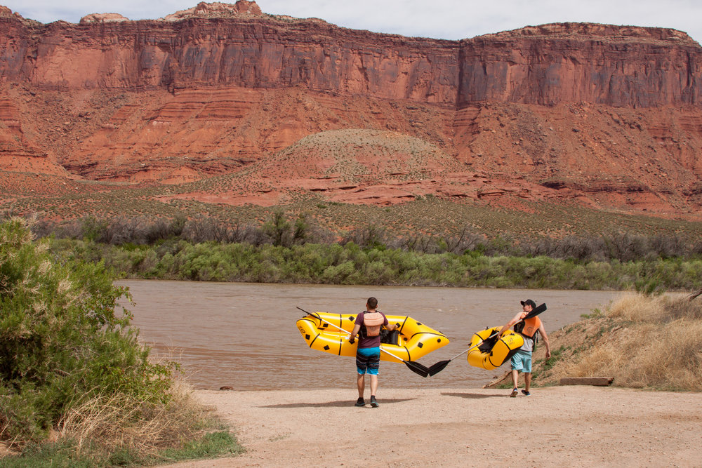 Walking out for a test spin on the Kokopelli Pack Rafts in Moab, Utah