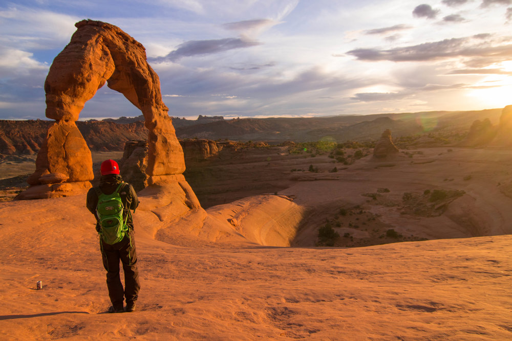 "Catching a sunrise or sunset at the infamous ""Delicate Arch"" is a must do while in Arches Nat. Park. Fun Fact if you aren't from Utah, its the Arch on most Utah vehicles plates."