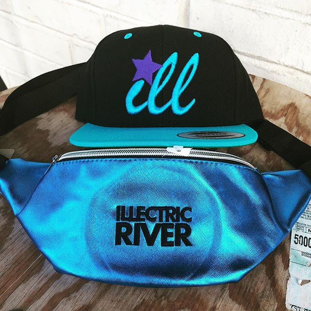 Fanny packs and snap backs hot off the machines. Do you have your tickets to @illectricriver ??? See you this weekend, it's going to be ILL 💙 #custom #merchandise #sneakpeak