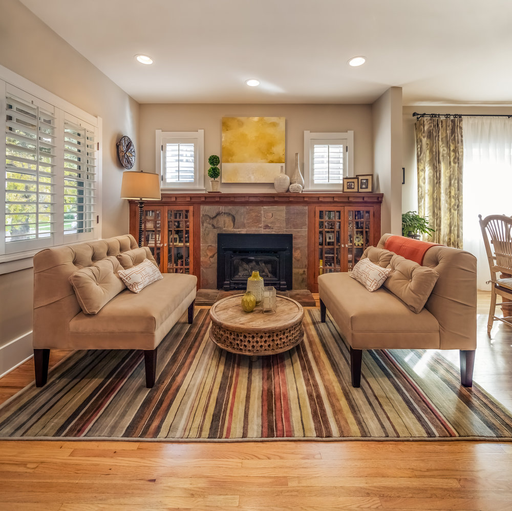 In the bungalow s very small  original living room we placed two matching  settees to unify. Denver Bungalow   Laura Medicus Interiors  A Denver Interior Designer