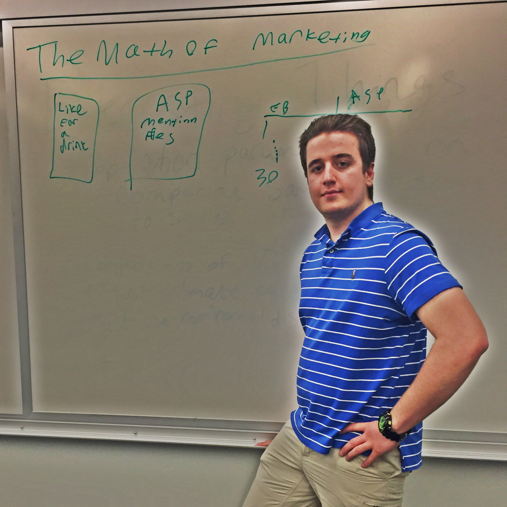 Student in front of whiteboard discussing the math of marketing