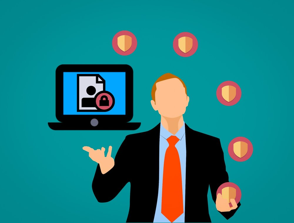 Cartoon of businessman juggling digital security shields with a computer and lock symbol as part of recent GDPR regulations implemented
