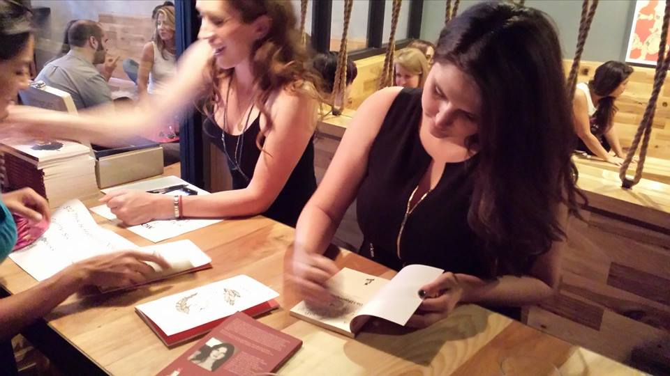 "Signing copies of ""This Is Happening Now"" at Wolf & Crane"