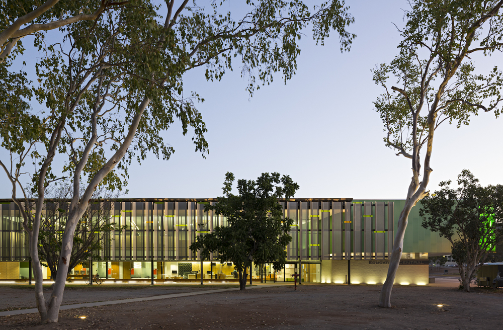 The northern elevation of Education Central with its perforated screen moderates glare and creates shade allowing the interiors to comfortably and visually connect with the landscape.