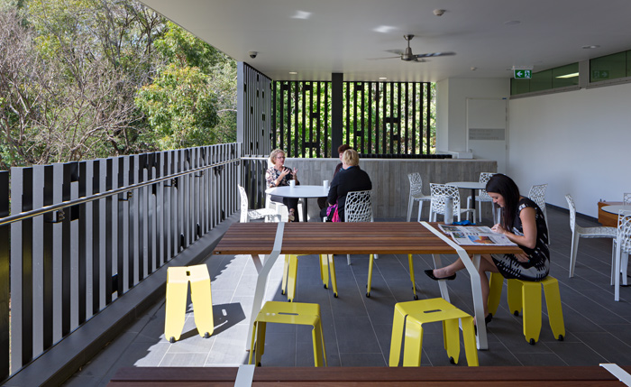 Staff can still find places to get away from students and reinforce their own community.  This outdoor flexible space has fabulous views into the heavily treed campus.