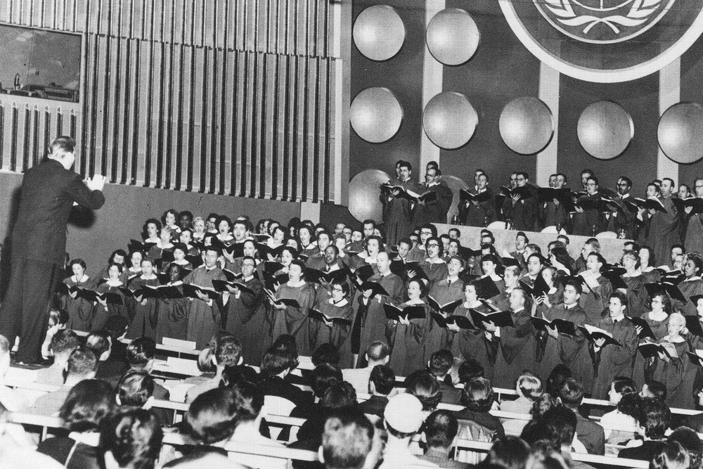 Robert Shaw conducts the Collegiate Chorale at the first session in the United Nations building, 1953.