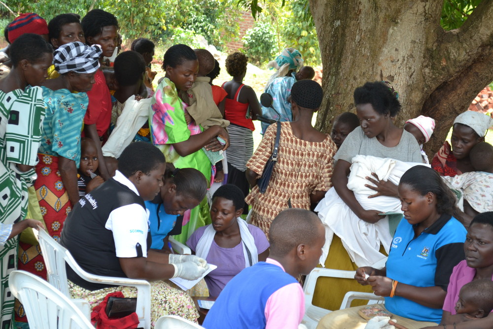 Women await HIV testing in Uganda [Credit: Plan]