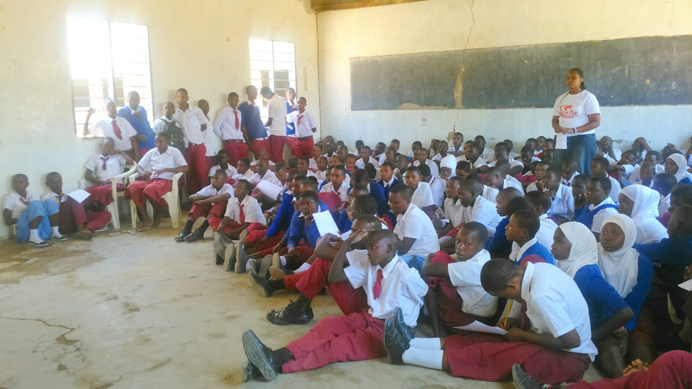 Students from Kilimatinde Secondary School listening to the presenters.JPG