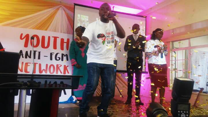 'Foreman' and Rose performing a music piece 'Say No to FGM' during the unveiling of the new logo