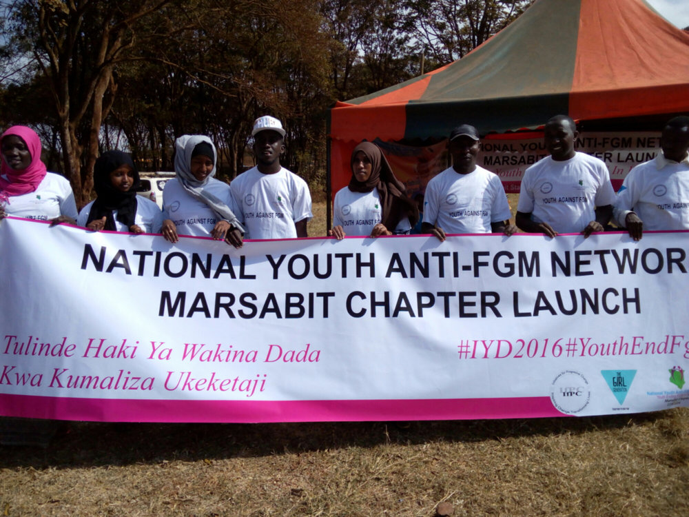 MEMBERS OF THE KENYA ANTI-FGM YOUTH NETWORK ADVOCATING FOR PRESERVATION OF GIRL RIGHTS DURING THE #YOUTH DAY