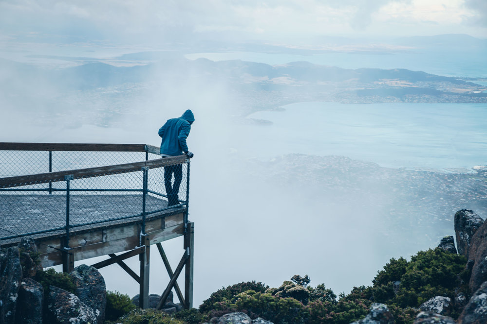 @nickinthewild standing on the platform looking out over Hobart
