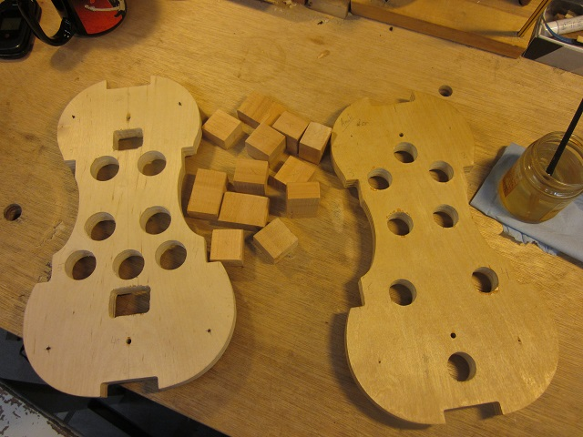 I make the body of the instrument with a mold inside the rib structure during construction.  The small notches in the form will hold the split blocks of willow.