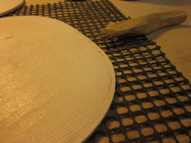 Now the plates are taken to their final edge thickness, and I start to cut the purfling channel.