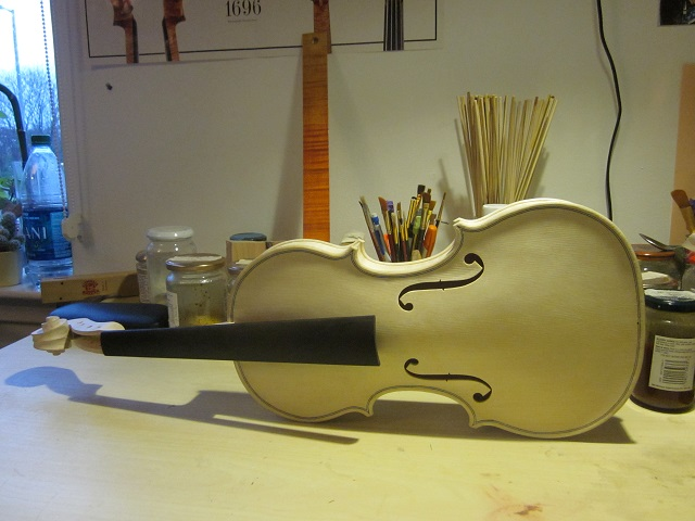After making the ebony fingerboard, setting the neck into the body, shaping the neck, and a final scraping, the violin is ready for varnishing...which is a whole other story!