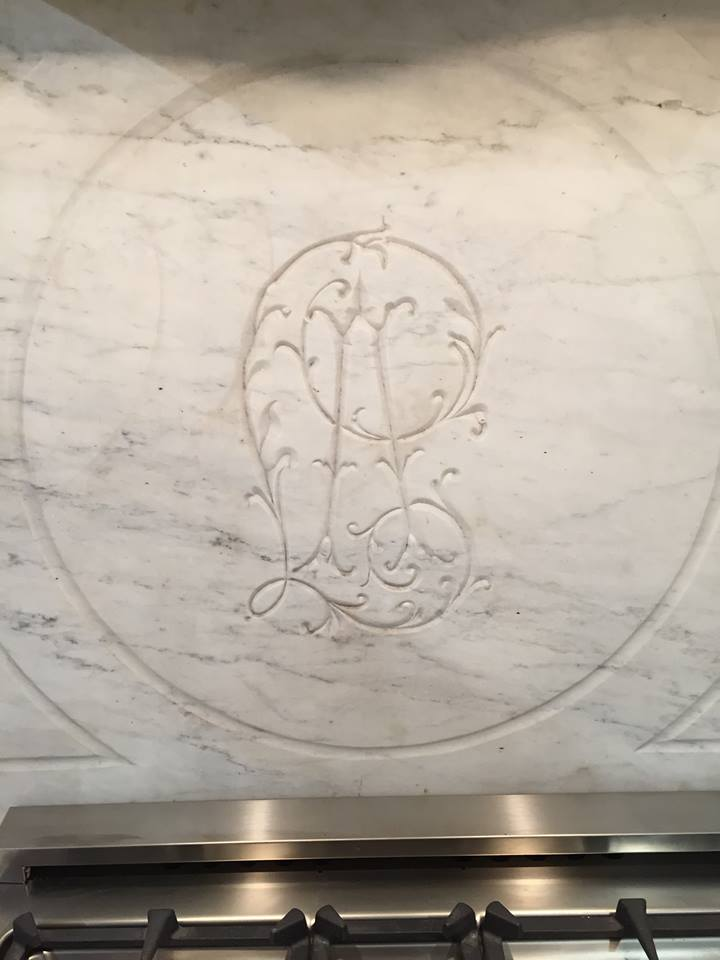 This piece of antique marble was spotted at market used as a backsplash in the kitchen of the fabulous new showroom, Eloquence, located on Wrenn Street. I'm in love with this carved design!