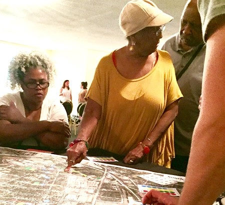 Members of the South Atlantic Civic League review a neighborhood map at a monthly meeting.