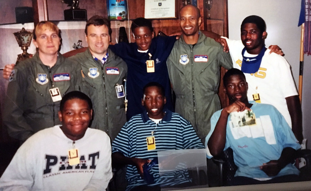 Chris Gray, second from the right in the top row, took a group of neighborhood teens to visit the Air Force Academy in Colorado many years ago.