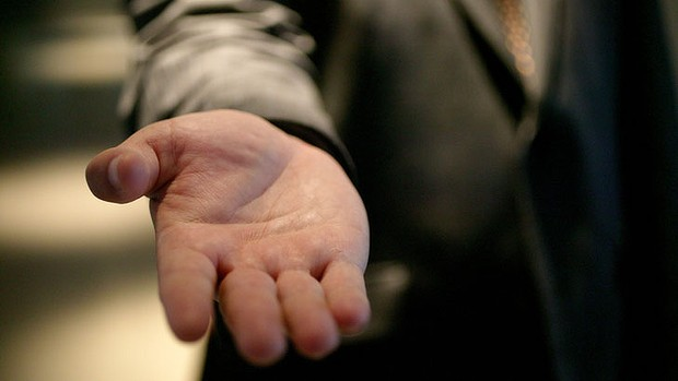 Image result for holding out a hand for handouts