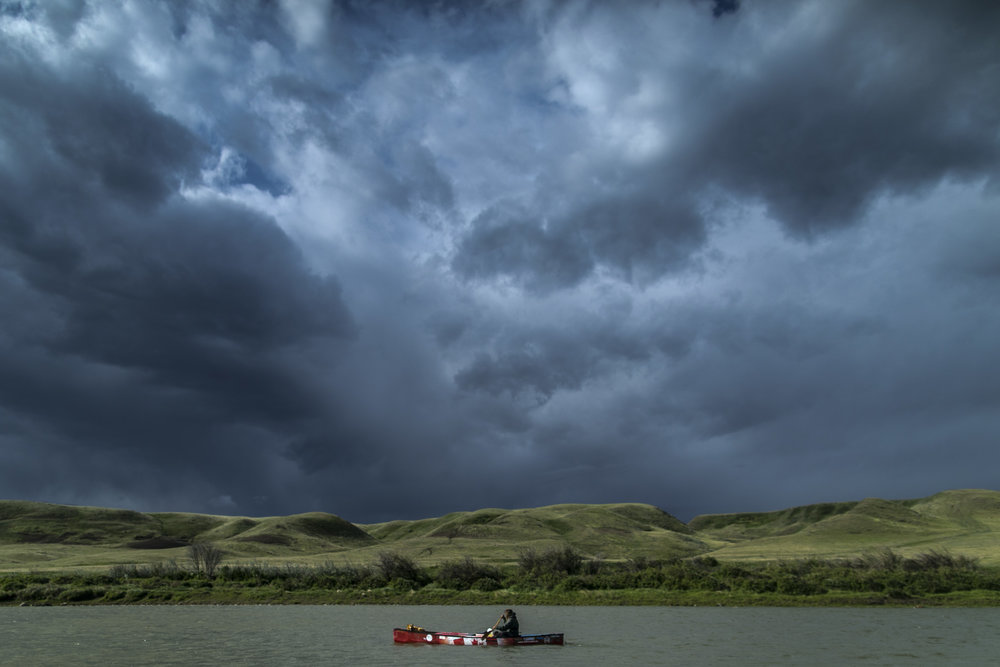 Mike rants woke to the sharp cracks of thunder as flashes of lightning quickly approached. In a panic, Ranta loaded his canoe and set off into the passing storm. After a morning of paddling through stormy skies, a trailer wind of a suspected micro burst or tornado swept, very aggressively, Ranta to shore.  20170524.  Photo/David Jackson