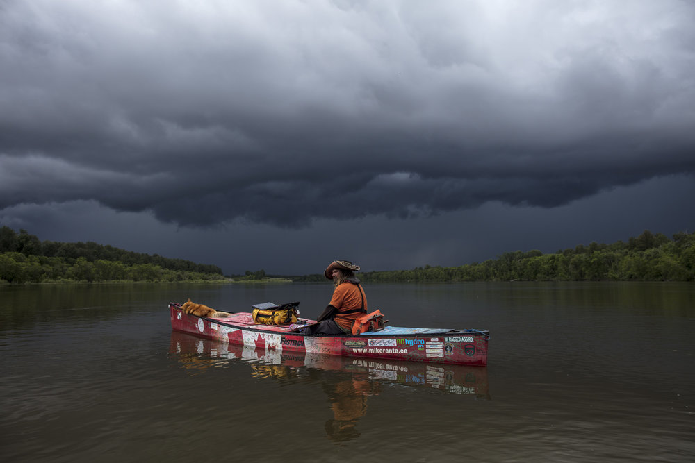The morning after Mike Ranta and Spitzii enter Manitoba, a major storm forces them to shelter at a trappers cabin on the Saskatchewan River, Manitoba. By nightfall, Ranta entertained questions and curious locals from The Pas. 20170619.  Photo/David Jackson
