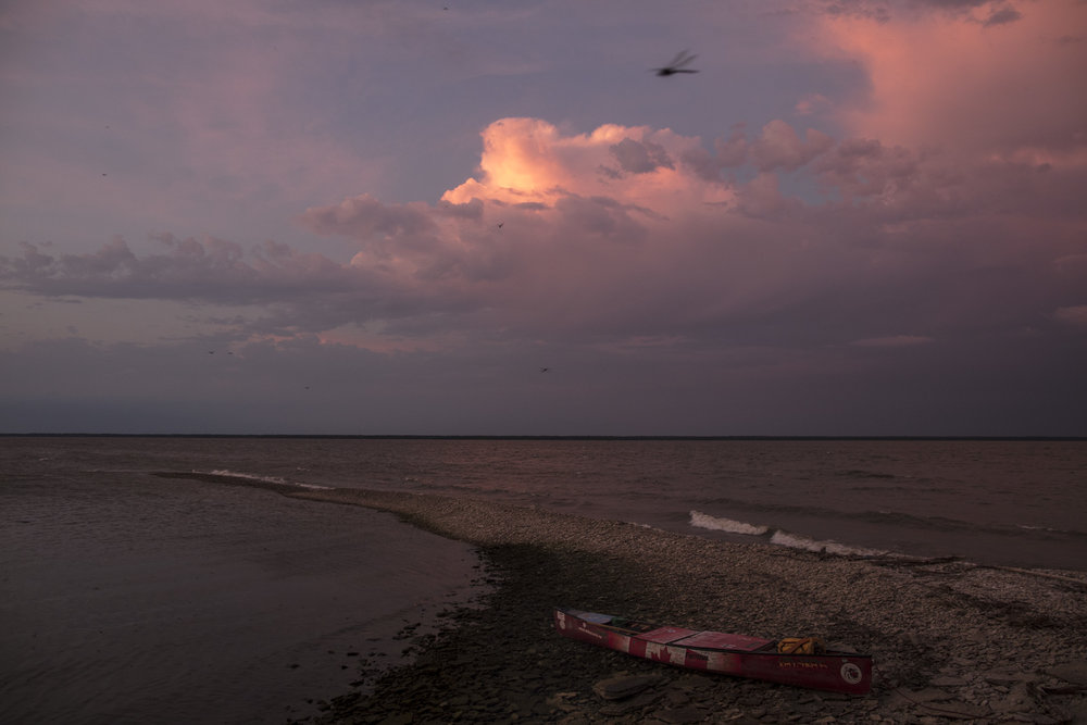 Travelling a hours before 8 am, Mike Ranta becomes wind bound just shy of Pine Dock in enormous winds on the south end of Lake Winnipeg, Manitoba.20170724.  Photo/David Jackson