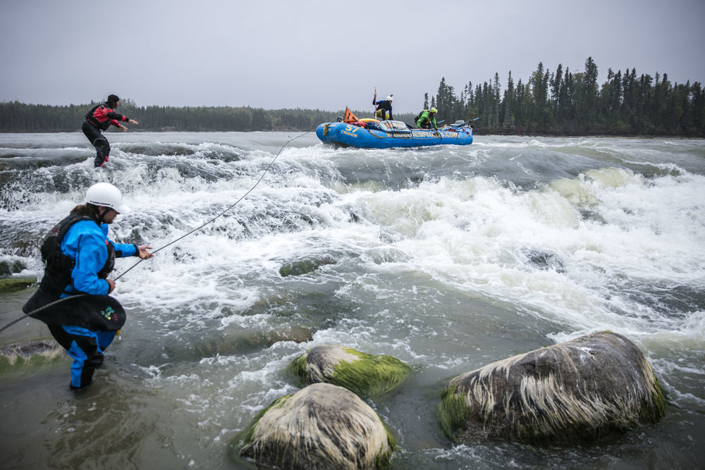 Hal Monkman tosses the rope to Ben Marr who prepares to anchor the raft as it is lined around potentially dangerous holes at Eve's Falls. Photo/David Jackson
