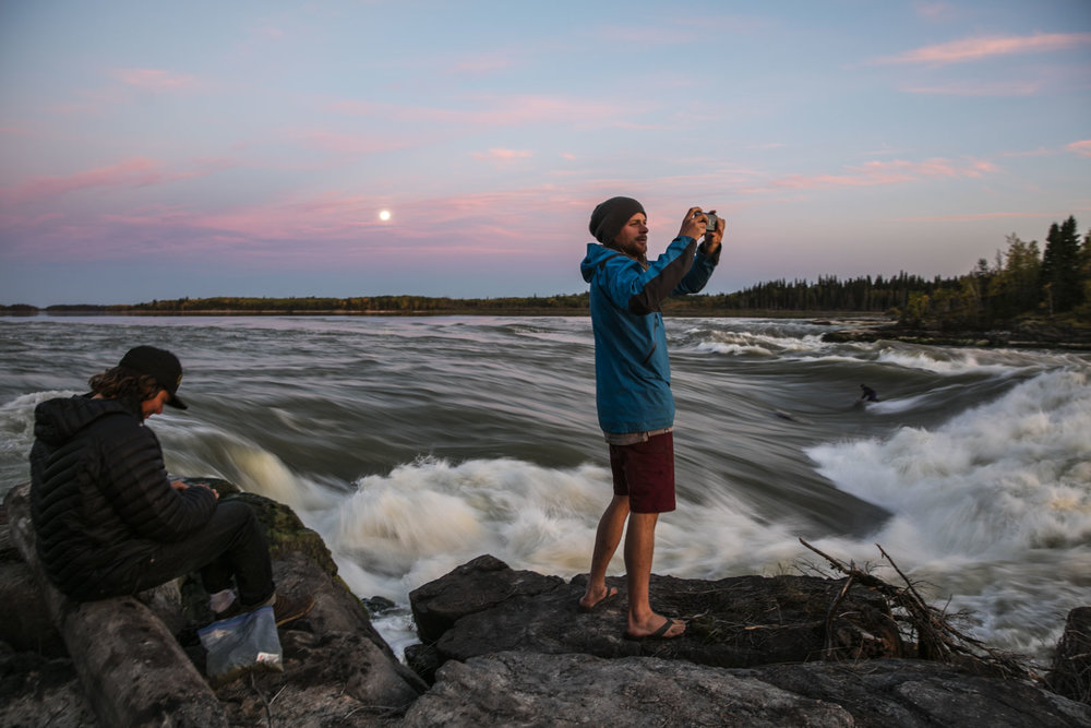 Ben Marr snaps a photo of sunset while Hal Monkman rolls a smoke, the Patterson brothers party surfing under a full moon.Photo/David Jackson