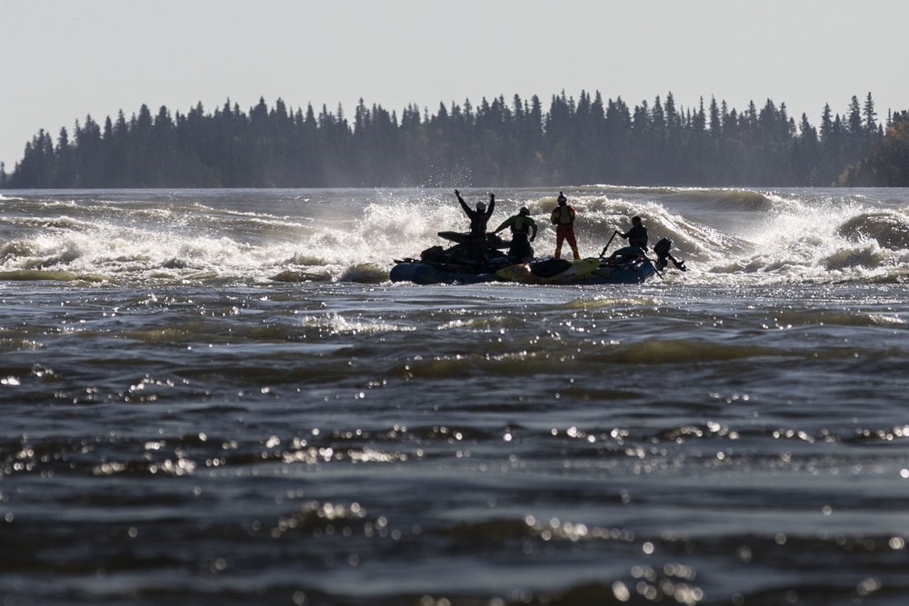 Ben Marr surfs Dream Wave at bladder falls during sunrise on the Nelson River , Manitoba.,Friday September 16, 2016.    Photo/David Jackson