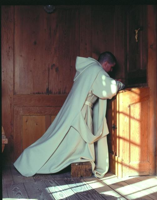 A Carthusian monk at prayer