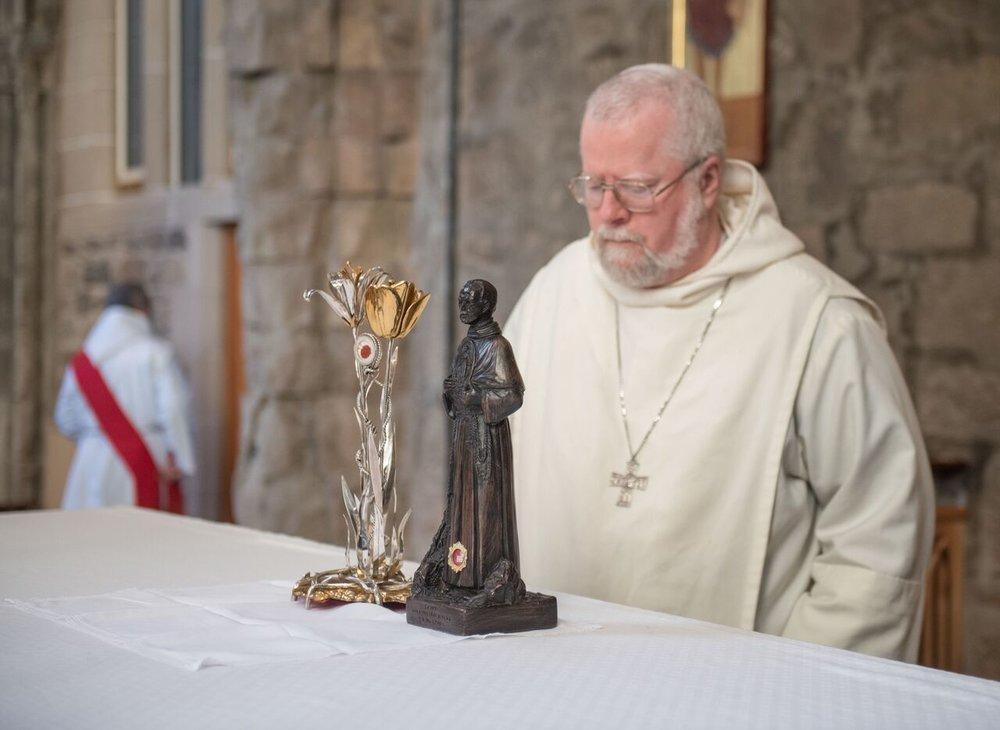 Fr. Abbot praying before S Maximilian's relics 2017.jpg